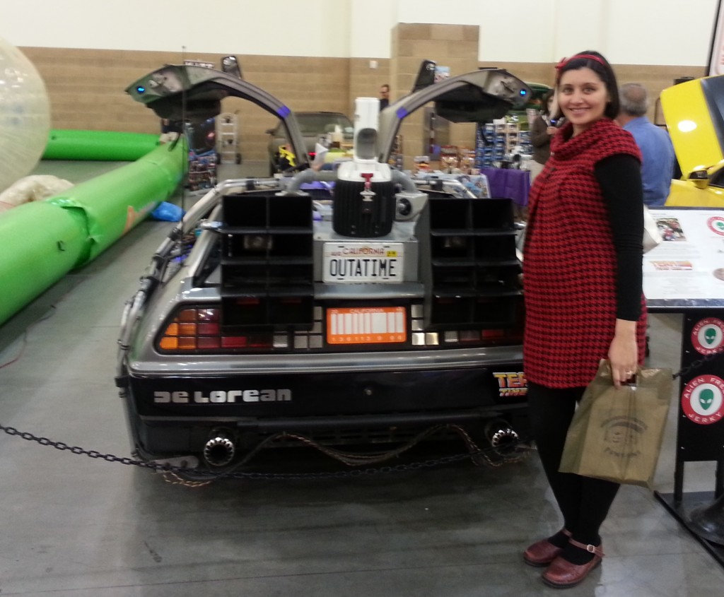 Simone with a belly! Baby boy Turkington poses with the De Lorean of what will the first of many times in his life.